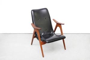Restauratie zwarte design fauteuil before